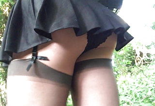 Dark hued micro skirt college girl in the forest .