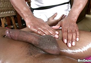 Massagist providing a hand job and having his jizz shotgun fellated