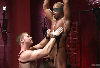 Muscular dark hued boy gets bonded